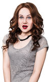 Beautiful surprised woman with lush wavy hair. Stock Images