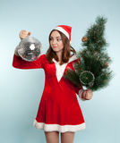 Beautiful surprised woman in new year costume with a new year ba Royalty Free Stock Photography