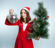 Beautiful surprised woman in new year costume with a new year ba Stock Photo