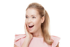 Beautiful surprised woman with perfect skin and face. Isolated. Royalty Free Stock Image