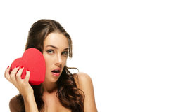 Beautiful surprised woman with a red heart Stock Photography