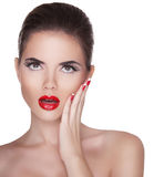 Beautiful surprised woman with red lips isolated on white backgr Stock Images