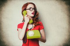 Beautiful surprised young woman with retro phone Stock Photo