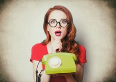 Beautiful surprised young woman with retro phone Royalty Free Stock Photo