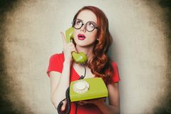 Beautiful surprised young woman with retro phone Stock Photos
