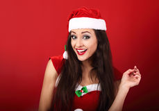 Beautiful surprising woman with open mouth in santa claus christ Stock Images