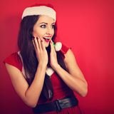 Beautiful surprising woman with open mouth in Santa Claus Christ Royalty Free Stock Photo
