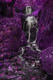 Beautiful surreal alternative color tall waterfall flowing over stock photos