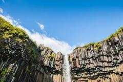 Beautiful Svartifoss waterfall with basalt columns Stock Photo