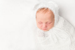 Beautiful swaddled baby in white closeup Royalty Free Stock Photo