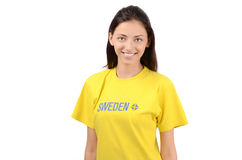 Beautiful Swedish girl. Attractive girl with Sweden flag on her yellow t-shirt. Isolated on white Stock Images