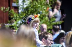 Beautiful swedish people and kids are enjoying traditional decoration of mid summer day wearing colourful crown in sunny day. Umea, Sweden - JUNE 23, 2017, mid royalty free stock photography