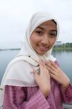 Beautiful and sweet Asian Malay Muslim lady Stock Photo