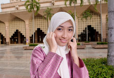 Beautiful and sweet Asian Malay Muslim lady. Photo of a beautiful asian malay muslim lady in traditional baju melayu costume, in front a mosque in Malaysia Stock Photos