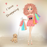 Beautiful, sweet, curly-haired girl. Beautiful, sweet, curly-haired girl with shopping bags and a dog Royalty Free Stock Photography