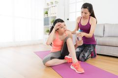 Beautiful fitness woman doing fitness workout. Beautiful sweet fitness women doing fitness workout at home feeling tired sitting on floor relaxing and female Stock Photo