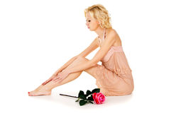 Beautiful sweet girl in a beige dress with a rose Royalty Free Stock Photos