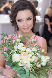 Beautiful sweet girl bridesmaid preparing for the wedding of a friend in the pink evening dress with evening hairstyle and bright Stock Photo
