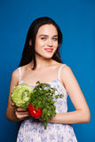 Beautiful sweet girl in a simple dress holding a cabbage Stock Photos