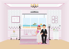 Beautiful sweet  hotel for just married couple . Beautiful sweet  hotel for just married couple sitting on bed with sweet swan couple put on honeymoon bed and Royalty Free Stock Photos