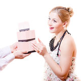 Beautiful sweet, sincere, gentle blond young woman received wonderful gifts in pink boxes from man's hands & happy smiling Stock Photos