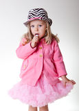 Beautiful sweet toddler girl in pettiskirt and zeb Stock Photo