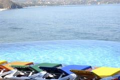 Beautiful Swimming Pool. Beautiful Infinity Swimming Pool facing the ocean stock images