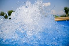 Beautiful swimming pool blue water background, spa and jacuzzi water detail with bubbles stock photo