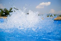 Beautiful swimming pool blue water background, spa and jacuzzi water detail with bubbles royalty free stock image