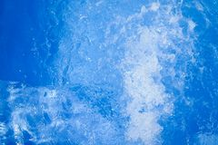Beautiful swimming pool blue water background, spa and jacuzzi water detail with bubbles royalty free stock photo
