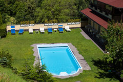Beautiful swimming pool with lawn around Stock Photography