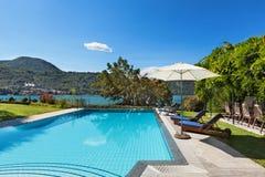 Beautiful swimming pool overlooking the lake Royalty Free Stock Photos