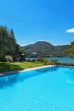 Beautiful swimming pool overlooking the lake Royalty Free Stock Photography