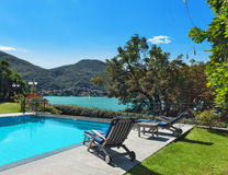 Beautiful swimming pool overlooking the lake Stock Images