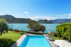 Beautiful swimming pool overlooking the lake Stock Photography