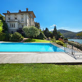 Beautiful swimming pool overlooking the lake Stock Photos