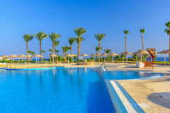 Beautiful swimming pool and palm trees in Egypt Stock Photo