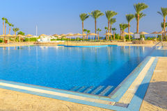 Beautiful swimming pool and palm trees in Egypt Royalty Free Stock Photos