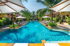 Beautiful swimming pool in public tropical resort , Phuket, Thai. Beautiful swimming pool in public tropical resort  Phuket, Thailand Royalty Free Stock Photography