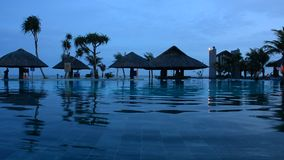 Beautiful swimming pool in tropical resort stock video footage