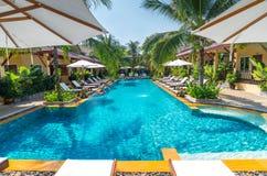 Beautiful swimming pool in tropical resort , Phuket, Thailand. Beautiful swimming pool in tropical resort at Phuket, Thailand Royalty Free Stock Images
