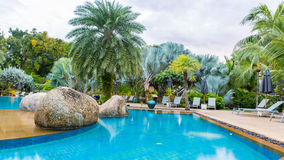 Beautiful swimming pool in tropical resort , Thailand. Royalty Free Stock Photos