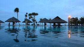 Beautiful swimming pool in tropical resort stock video