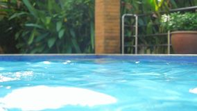 Beautiful swimming pool with reflected water in villa on sunshine in slow motion. 1920x1080. Beautiful swimming pool in villa with reflected water on sunshine in stock video