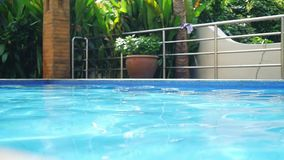 Beautiful swimming pool in villa with reflected water on sunshine in slow motion. 1920x1080. Hd stock footage