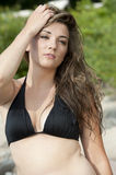 Beautiful Swimsuit Model. A gorgeous brunette young model posing on a sunny day at the beach Royalty Free Stock Image
