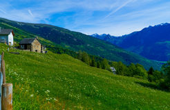 Beautiful Swiss landscape with a house in the alps in the summer. Royalty Free Stock Photography