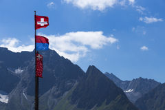 Beautiful switzerland flag with mountain Royalty Free Stock Photos