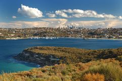 Beautiful Sydney Skyline with ocean bay Stock Photos
