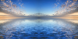 Beautiful syk reflected in calm sea waters Stock Images